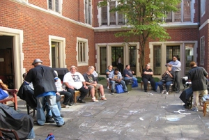 Congregating in outdoor common area.