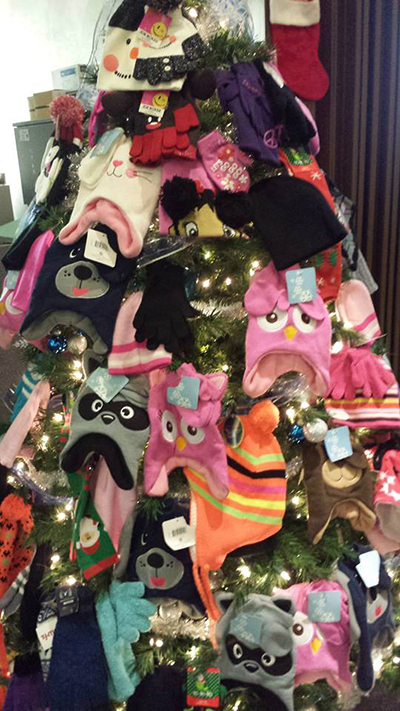 Christmas Tree foull of children's hats