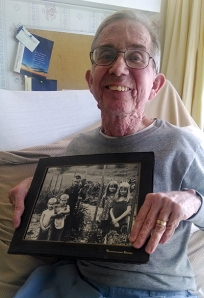 David Hollingsworth holding old photo