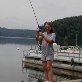 Girl catches fish