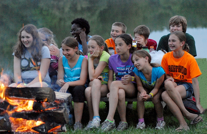 Kids sitting by the campfire