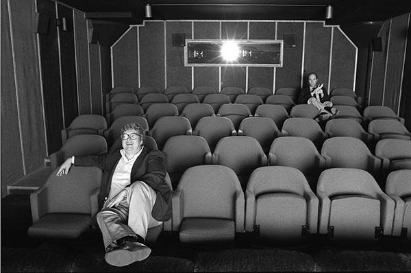 Gene Siskel and Roger Ebert in screening room for photo shoot