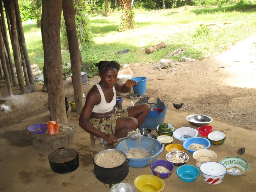 Woman with Rice Buckets