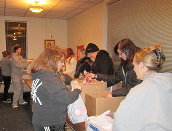 Pastor Dick Smith and Brookfield UMC  members packing supplies for Brookfield Backpack Charitable Fund.