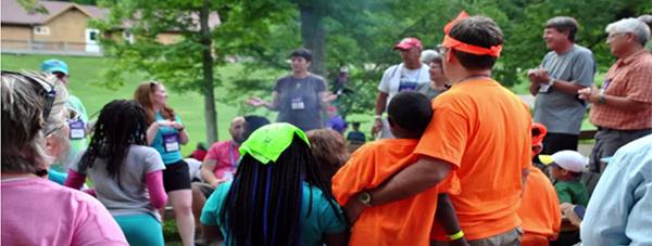 Royal Family Kids Camp - gathering around