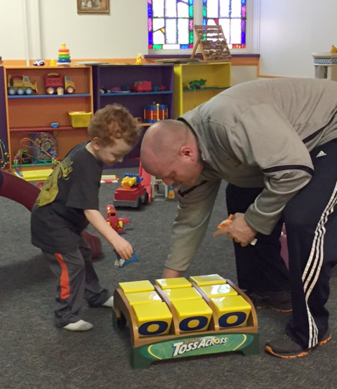 Man playing with toddler