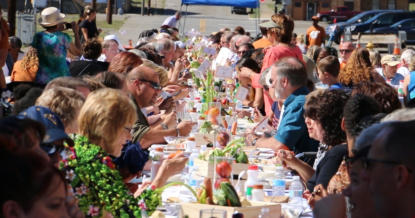 People eating at Longest talbe