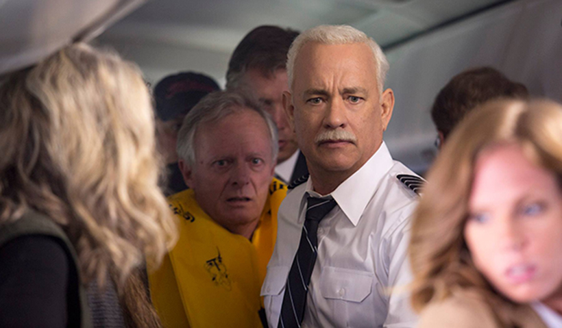Capt. Sully with passengers inside airplane