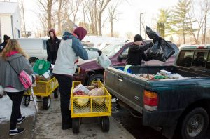 Loading up cars and trucks with Christmas goods and food