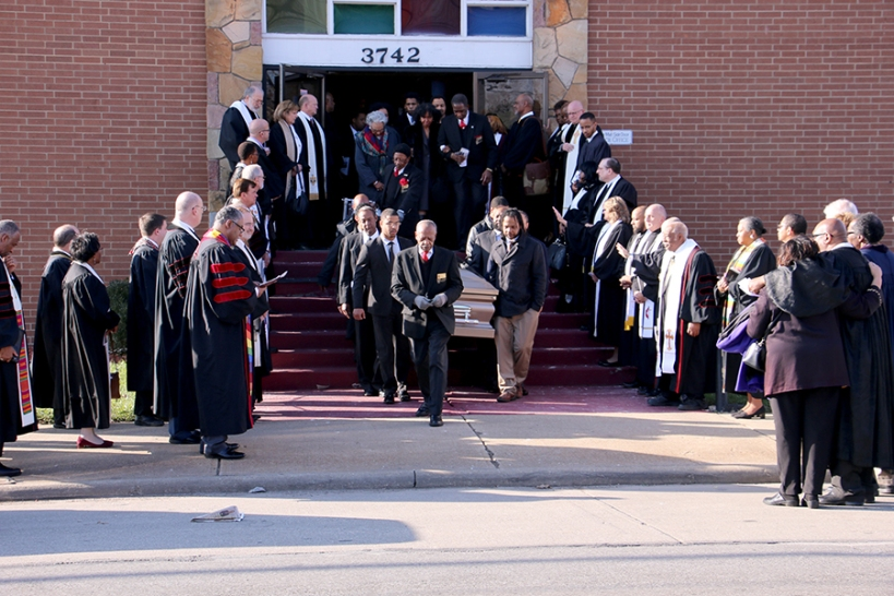 Pastors outside of church, pallbearers carry Chaffee's coffin