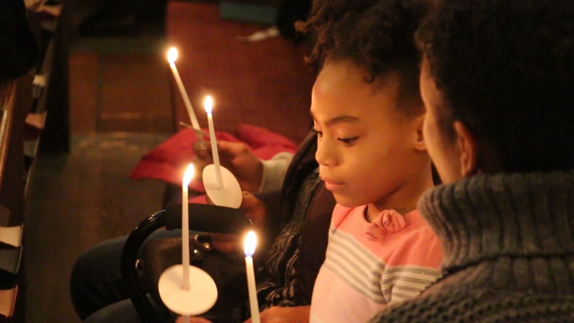 Girl lighting candles