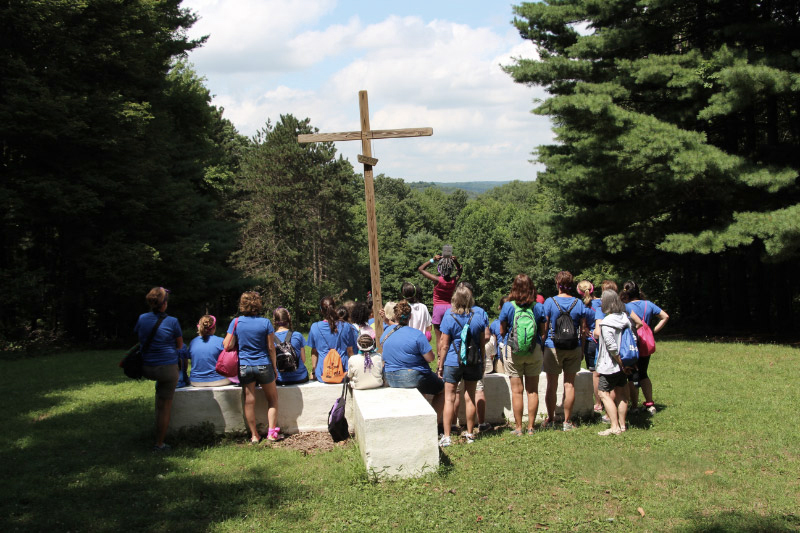 A group of campers and staff at the cross.