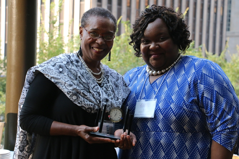 Bishop Linda Lee accepted a gift on behalf of Bishop Cynthia Moore-Koikoi from the Rev. Telley Lynette Gadson