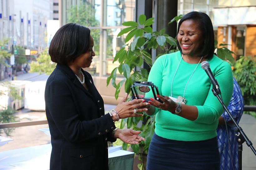 Rev. Yvette Massey presents a gift to Bishop Sharma Lewis