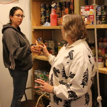 The Rev. Abby Auman and the Rev. Gail Angel work in The Nehemiah Mission food pantry.