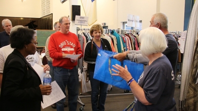 Volunteers from the Twice Blessed store speak to the Cabinet
