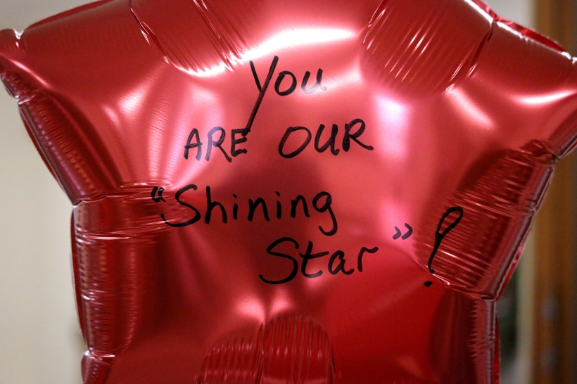 Red star ballonn - you are our shining star written on it.