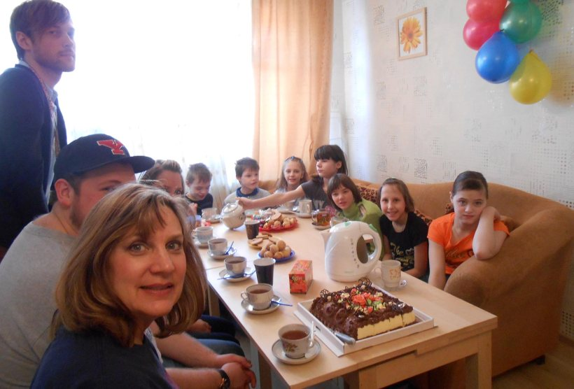 Ukraine children at a table with mission team
