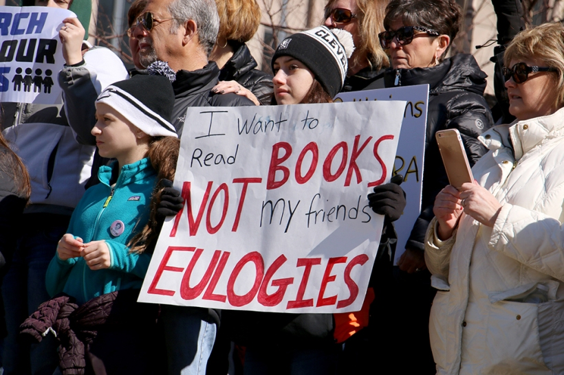 "A student makes her feelings known at the Cleveland rally with a sign that reads. ""I want to read books not my friends' eulogies."""