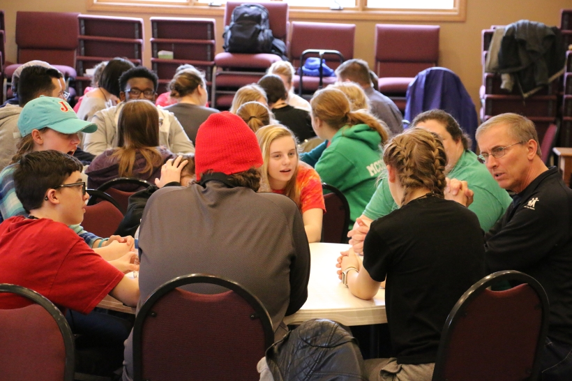 youth and leadership discuss at round tables