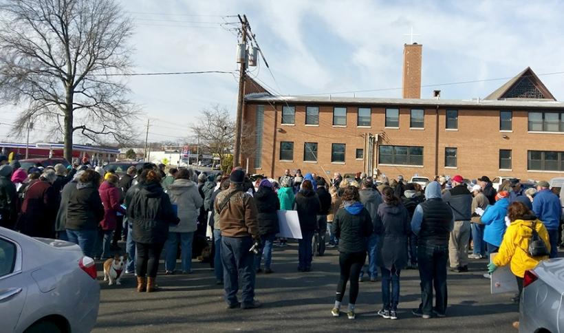 Rev. Jon Priebe prays to a large crowd at the Ashland rally.