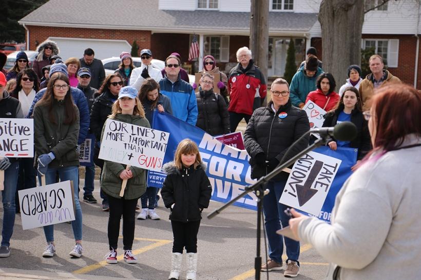 Rev. Paige Boyer speaks to marchers