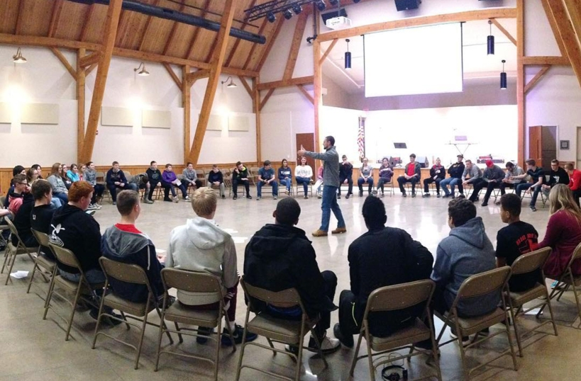 Solid Rock Retreat - Youth gathered in large circle in gym
