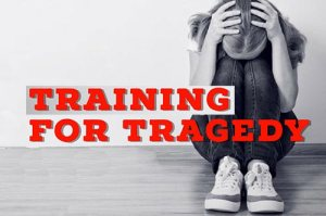 Training for Tragedy - girl sitting on floor with hands on top of head , which is bowed down