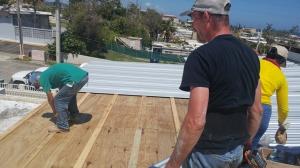 Volunteers on roof