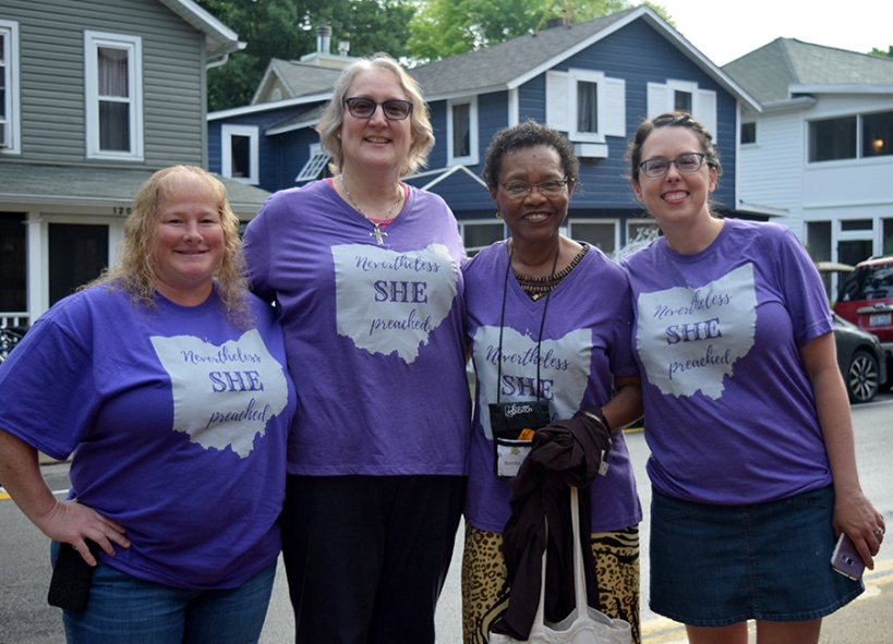 Four women wear Nevertheless, she preached t-shirts