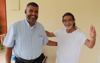 Pastor Isabelino Rivera Silva and Homeowner Junito