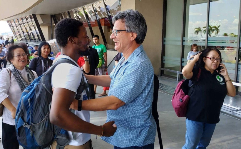 Tawanda Chandiwana greeted by Thomas Kemper, top executive of Global Ministries