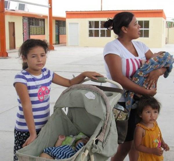 Mother, children waiting in the heat