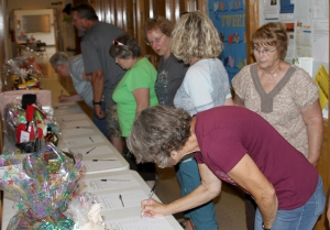 people signing up for raffle tickest and auction
