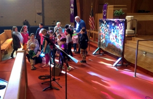 Children in sanctuary getting messy