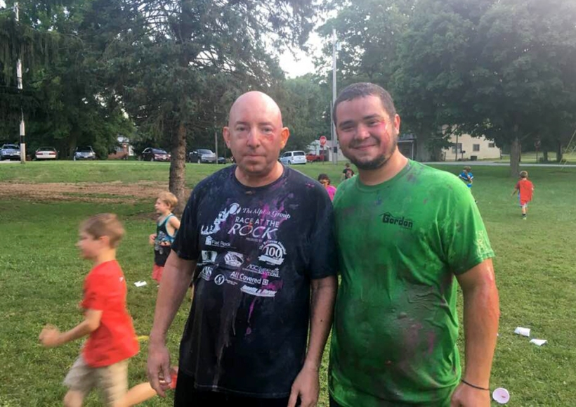 Pastor and adult get wet and dirty
