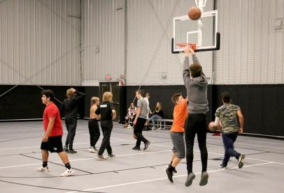 Teens playing basketball