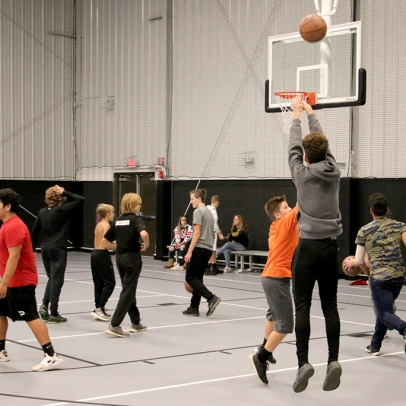 Teens playing basketball