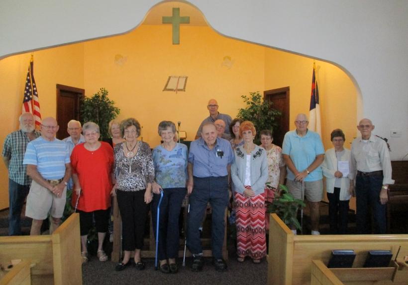 Bigelo church members in sanctuary
