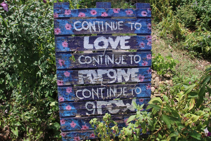"Sing in garden reads ""continue to love continue to forgive continue to grow"