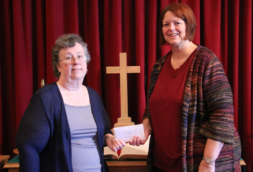 Pastor receives monies raised for missions.