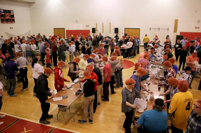 Full view of youth packing meals